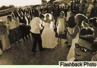 Bride and Groom dancing by Flashback Photography